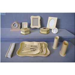 A selection of vintage French Ivory vanity pieces including nail tools, buffers, hair receiver plus
