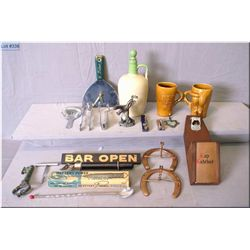 A selection of bar collectibles including stoneware gin bottle, putty knife clock, corkscrews, horse