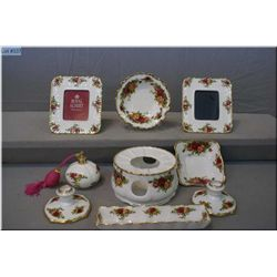 A selection of Royal Albert  Old Country Roses  including candle holders, picture frames, perfume bo