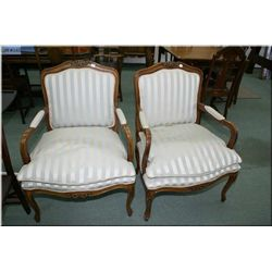 Two French style open arm parlour chairs with tasteful carving