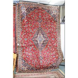 Iranian wool area rug with large center medallion and overall geometric floral design in shades of c