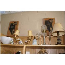 A selection of vintage collectibles including figural lamp, candle holders, oil lamp etc. plus a flo