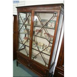 Antique Asian influenced display cabinet with upper glazed doors and matched grain raised panel lowe