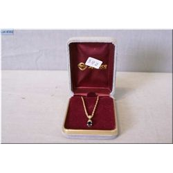 Lady's 10kt yellow gold neck chain with sapphire pendant