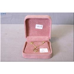 "Lady's 10kt yellow gold 24"" neck chain and 10kt gold pendant"