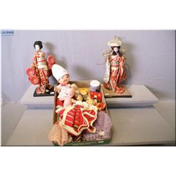 A selection of vintage dolls including two Japanese dolls in kimonos, Campbell's soup kid, travel do