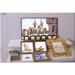 A selection of wall hangings including cast framed bevelled mirror, painted tiles, pictorial tile co