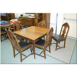 Extending dining table with five insert leafs and five dining chairs