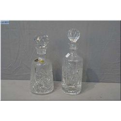 Two crystal decanters with stoppers, one labelled Czechoslovakia