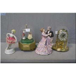 Three musical figurines and an Anniversary style domed clock