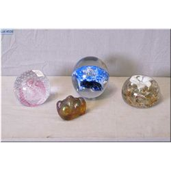 Four art glass paperweights, one signed