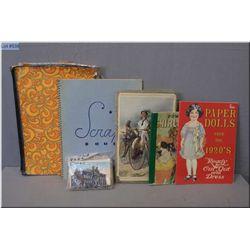 A selection of vintage ephemera including postcards, scrapbooks, Shirley Temple book etc.