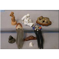 Selection of collectibles including small masks, cast incense burner, soapstone carving, clay figure