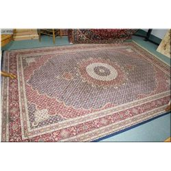"Large synthetic area rug in shades of burgundy and royal blue 140"" X 92"""