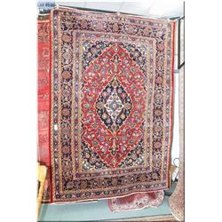 Iranian wool area rug with center medallion, multiple border, floral motif in shades of navy, red an