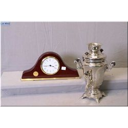 A chrome electric Samovar and a modern quartz presentation clock