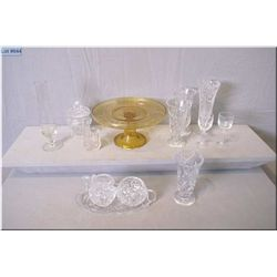 A selection of crystal and pressed glass including cake comport, vases, cream, lidded sugar and drip