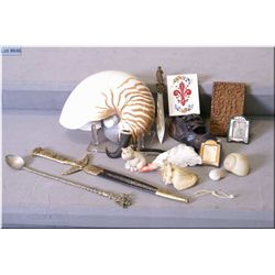 Selection of collectibles including large shell, antique baby shoes, daggers, treenware calling card