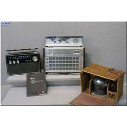 A Phillips FM/AM Deluxe shortwave radio with manual, a Koyo radio and a vintage portable kettle in b
