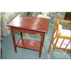 Vintage side table with sculpted skirt and reeded supports