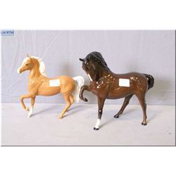 Two Royal Doulton horses