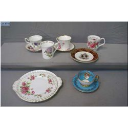 A selection of china cups and saucers including Addersley, Royal Albert, Aynsley Royalty cup etc.