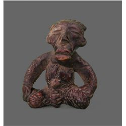 Clay artifact of a seated figure. (Size: See last photo