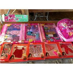 lot of 8 Barbie's and bag