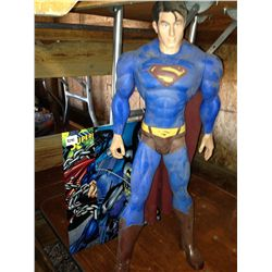 Superman doll and 2 metal signs