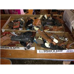 lot of cap guns and holsters