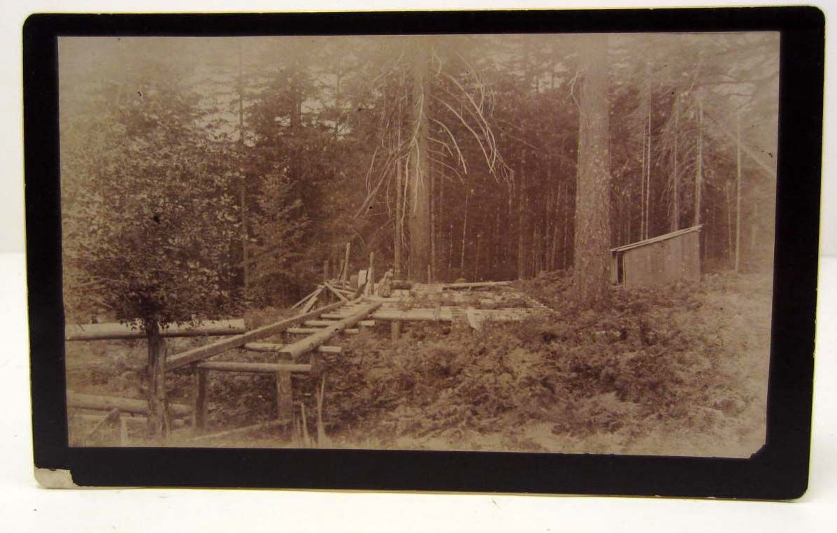 HISTORIC MOUNTED PHOTO OF A SAWMILL UNDER CONSTRUCTION IN COLUMBIA CITY  OREGON
