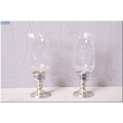A pair of Birks sterling candle holder and Birks sterling and etched glass hurricanes