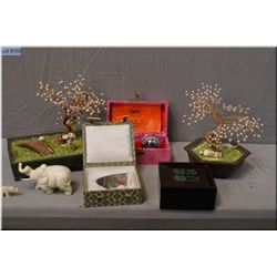 Selection of Oriental collectibles including trees, carved bone elephant, stress, healing balls etc.