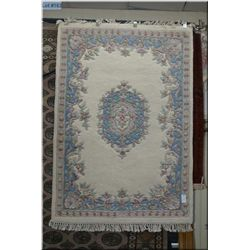 "Heavy wool area rug with center medallion, cream background 49"" X 72"""