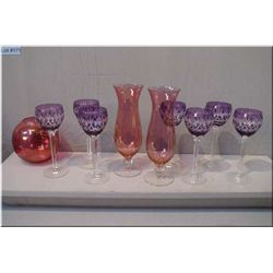 Seven amethyst cut to clear crystal goblets, and three pieces of cranberry flash