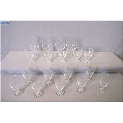 A selection of candlewick and etched glass ware including nine grape motif wine glasses, five polka