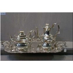 Vintage silverplate tea set including coffee and teapot, cream and sugar on a grape motif double han