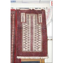 """Small wool carpet in shades of red and cream 57"""" x 38"""""""