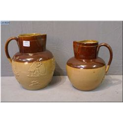"""Two Doulton Lambeth stoneware pitcher, one figural and one plain, 8 1/2'"""" and 7"""""""