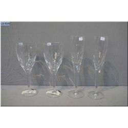 A pair of John Rocha for Waterford crystal red wine glasses and champagne flutes
