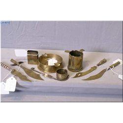 Selection of vintage trench art including knives, napkin ring, bracelet, match holder and ashtrays