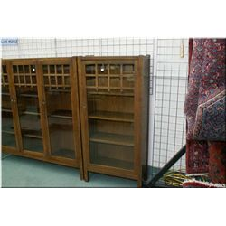 Antique quarter cut oak Mission style single door bookcase made by North American Furniture Co. Owen
