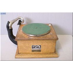 A vintage Victor table top gramophone in wooden case with record storage