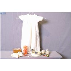 Selection of baby items including dress with under slip, sterling flatware, baby dish, rattle, leath