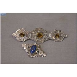 Two antique silver brooches, one set with cabochon stone and marked 925