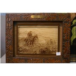"""A vintage framed Russell print on glass """"Wagon Boss"""" and a framed needlepoint bird"""