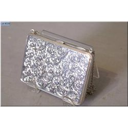 Ladies heavily chaised sterling silver purse marked with British sterling hallmarks