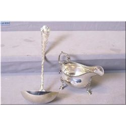 Sterling silver footed sauce boat marked with British hallmarks and a Birks sterling punch ladle