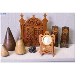 Selection of vintage treenware including frames, pencil holders, meditation figure and three graduat
