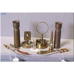 Selection of vintage trench art including vases, button hooks, ashtray, match holder, shaker, knives